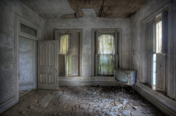 PIC BY MATTHEW CHRISTOPHER / CATERS NEWS - (PICTURED: An abandoned house in Western PA, 2011.) A photographer has travelled across America snapping the beautiful decay of the countrys abandoned HOUSES. Matthew Christophers eerie images include family heirlooms, rotting furniture and hanging clothes - all left behind by previous tenants. The snapper, 38, whose Abandoned America Facebook page has more than a quarter-of-a-million followers, travelled to New Jersey, Maryland, Connecticut, Indiana and New York for the series - as well as across his home state of Pennsylvania. Matthews reputation for shooting abandoned buildings grew from his haunting pictures of the likes of churches, factories, hospitals and asylums. - SEE CATERS COPY