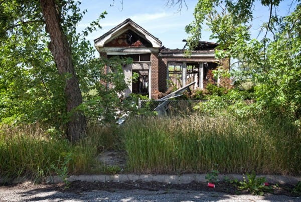 PIC BY MATTHEW CHRISTOPHER / CATERS NEWS - (PICTURED: An abandoned house in Gary, IN 2015.) A photographer has travelled across America snapping the beautiful decay of the countrys abandoned HOUSES. Matthew Christophers eerie images include family heirlooms, rotting furniture and hanging clothes - all left behind by previous tenants. The snapper, 38, whose Abandoned America Facebook page has more than a quarter-of-a-million followers, travelled to New Jersey, Maryland, Connecticut, Indiana and New York for the series - as well as across his home state of Pennsylvania. Matthews reputation for shooting abandoned buildings grew from his haunting pictures of the likes of churches, factories, hospitals and asylums. - SEE CATERS COPY