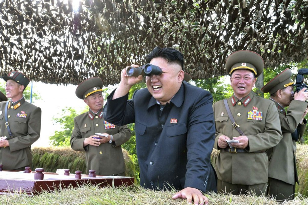 North Korean leader Kim Jong Un looks through a pair of binoculars during an inspection of the Hwa Islet Defence Detachment standing guard over a forward post off the east coast of the Korean peninsula, in this undated photo released by North Korea's Korean Central News Agency (KCNA) in Pyongyang on July 1, 2014. REUTERS/KCNA (NORTH KOREA - Tags: POLITICS MILITARY MARITIME TPX IMAGES OF THE DAY) ATTENTION EDITORS ? THIS PICTURE WAS PROVIDED BY A THIRD PARTY. REUTERS IS UNABLE TO INDEPENDENTLY VERIFY THE AUTHENTICITY, CONTENT, LOCATION OR DATE OF THIS IMAGE. FOR EDITORIAL USE ONLY. NOT FOR SALE FOR MARKETING OR ADVERTISING CAMPAIGNS. NO THIRD PARTY SALES. NOT FOR USE BY REUTERS THIRD PARTY DISTRIBUTORS. SOUTH KOREA OUT. NO COMMERCIAL OR EDITORIAL SALES IN SOUTH KOREA. THIS PICTURE IS DISTRIBUTED EXACTLY AS RECEIVED BY REUTERS, AS A SERVICE TO CLIENTS - RTR3WLEA