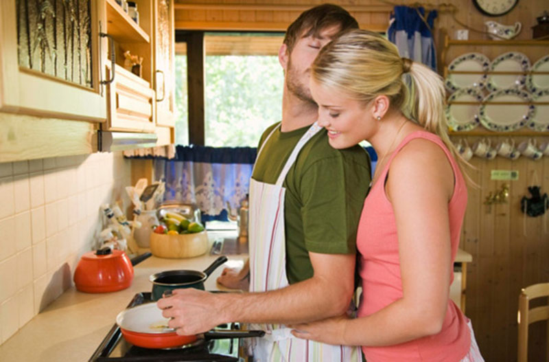 Couple showing affection in kitchen