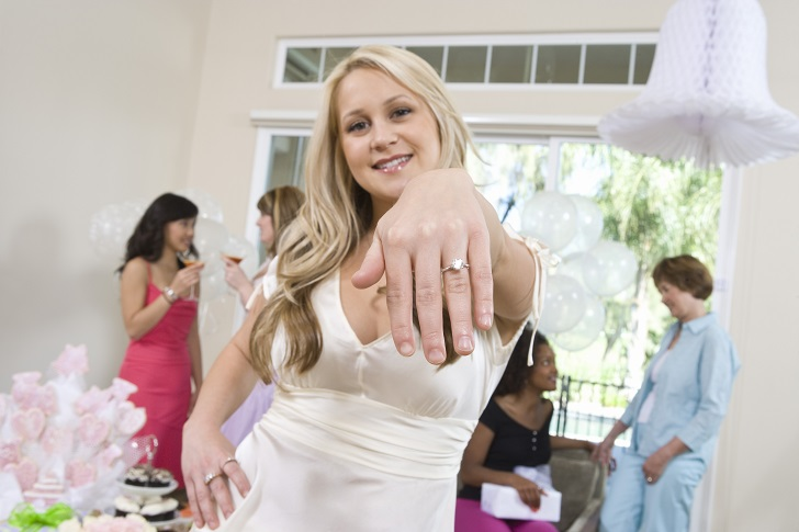 Young woman showing engagement ring Royalty free: For comercial usage price on demand