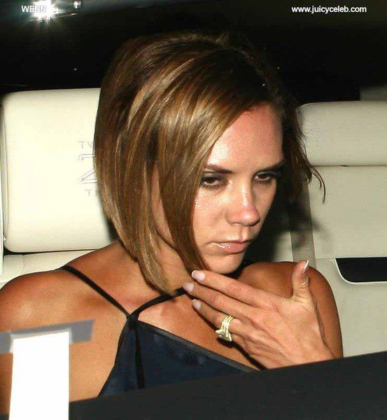 Victoria Beckham leaving Il Sole restaurant out the back door where photographers, fans, security and her Rolls Royce Phantom are waiting for her. The Spice Girl looked like she had a good evening with husband David helping her to their car. When: 14 Jul 2008 Credit: WENN