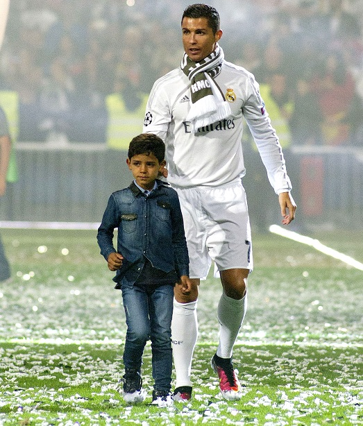 Mandatory Credit: Photo by Belen Diaz/DYDPPA/REX/Shutterstock (5697031b) Cristiano Ronaldo with son Cristiano Ronaldo Jr Real Madrid celebrate winning the Champions League, Football, Spain - 29 May 2016
