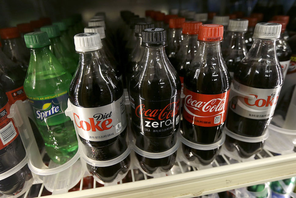 A shelf of soft drinks are shown in a refrigerator at K & D Market in San Francisco, Wednesday, Oct. 1, 2014. A tax on sodas and other sugar-laden drinks that voters and courts in other parts of the country have rejected is on the November ballots in San Francisco and Berkeley, two cities that have been open to such social-engineering initiatives in the past. (AP Photo/Jeff Chiu)