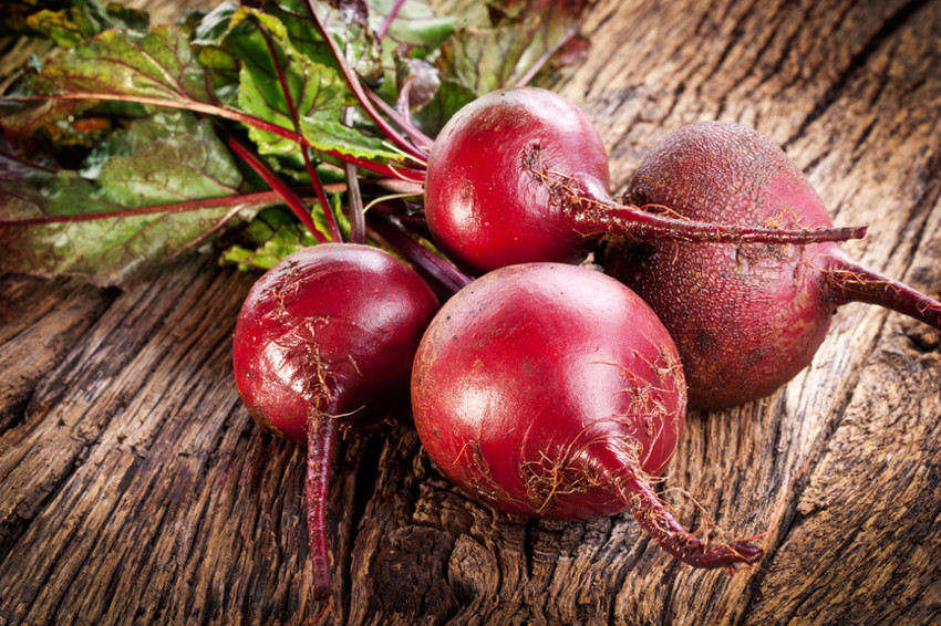Beet roots on a old wooden table.