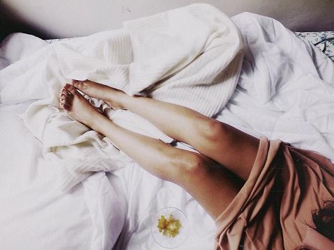 Female Legs On Bed